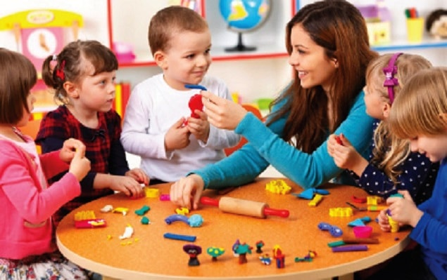 A successful graduate of Yorke Institute working in a childcare centre who studied childcare courses in melbourne at Yorke Institute